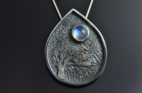 Lone tree under a blue moon contemporary silver pendant.