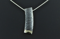 Textured, 18ct gold and blackened silver pendant