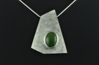 Five sided textured silver pendant with oval Pounamu