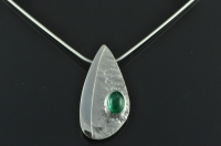 Asymmetric reticulated Sterling silver and Emerald pendant