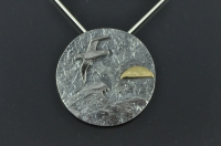 Albatross at sea with 22ct gold sunrise silver pendant