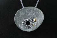 Reticulated, granulated, black and gold, asymmetrical silver pendant