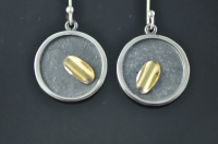 Golden trough, textured closed, blackened silver earrings