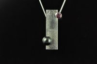 South Pacific Black pearl, Ruby and reticulated Sterling silver pendant