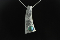 Paua pearl and hammer forged Sterling silver pendant