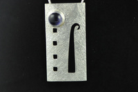 Arts and Crafts style silver and Iolite pendant