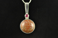 Agatised Dinosaur bone, Ruby and silver pendant